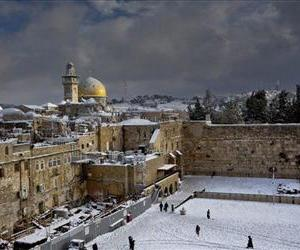 Western Wall and the Dome of the Rock, some of the holiest sites for for Jews and Muslims, are covered in snow in Jerusalem, Dec. 13, 2013.