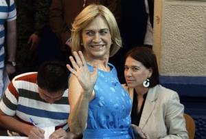 Chile's presidential candidate Evelyn Matthei, waves before casting her vote during presidential elections in Santiago, Chile, Sunday, Dec. 15, 2013.