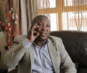 Thamsanqa Jantjie gestures at his home during an interview with the Associated Press in Johannesburg, South Africa, Dec. 12, 2013.