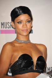 Rihanna poses backstage with the Icon award at the American Music Awards at the Nokia Theatre L.A. Live on Sunday, Nov. 24, 2013, in Los Angeles.
