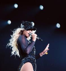 Beyonce performs onstage at her Mrs. Carter Show World Tour 2013, on Friday, Dec. 13, 2013 at the United Center in Chicago, Ill.