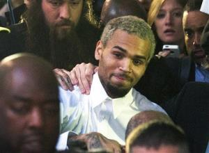 FILE - In this Monday, Oct. 28, 2013 file photo, singer Chris Brown, center, departs the H. Carl Moultriel courthouse after he was released from jail following his arrest for allegedly punching another man, in Washington. A representative for the R&B star announced Tuesday, Oct. 29, 2013 that Brown has...