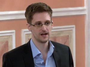 In this image made from video released by WikiLeaks on Friday, Oct. 11, 2013, former NSA systems analyst Edward Snowden speaks during a presentation ceremony for the Sam Adams Award in Moscow.