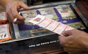 Mega Millions lottery tickets sell at a brisk pace in Laveen, Arizona, yesterday.