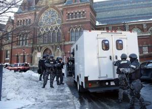 SWAT team officers arrive at a building at Harvard University after the bomb threat earlier this week.
