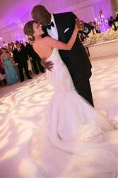 In this April 27, 2013, photo provided by JUMP.DC, Charlotte Bobcats owner Michael Jordan dances with his bride Yvette Prieto during their wedding reception at the Bear's Club in Jupiter, Fla.