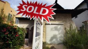 In this Monday, Sept. 2, 2013 photo, a sold sign is posted outside a house in Long Beach, Calif.