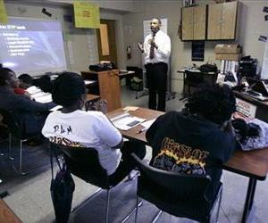 Teenagers sit in class at MetEast High School in Camden, NJ, in this June 17, 2009 file photo.