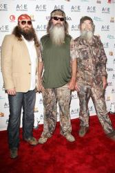In this May 9, 2012, photo, Willie Robertson, left, Phil Robertson, center, and Si Robertson pose at the A&E Networks 2012 Upfront at Lincoln Center in New York.