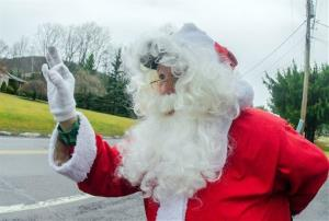 A man wearing a Santa Claus suit gestures toward a motorist in this file photo.