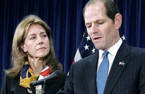 In this March 12, 2008, file photo, New York Gov. Eliot Spitzer announces his resignation as wife Silda stands by. The Spitzers announced last night that they are kaput.