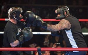 Jose Canseco, right, and Tareq Salahi exchange blows  during the Celebrity Fight Night on Saturday, Nov. 5, 2011, in Hollywood.
