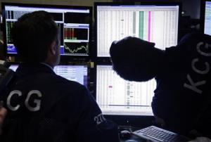 Specialists look at screens at their post on the floor of the New York Stock Exchange.