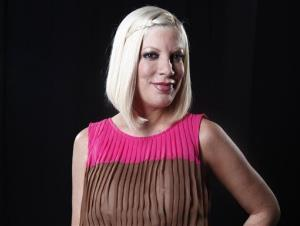 In this April 3, 2012 file photo, actress Tori Spelling poses for a portrait in New York.