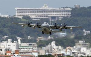 In this Aug. 16, 2012 photo, a C-130 transport plane takes off from the U.S. Marine Corps base in Futenma.