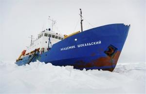 In this Friday, Dec. 27, 2013, file photo, the Russian ship MV Akademik Shokalskiy is trapped in thick Antarctic ice 1,500 nautical miles south of Hobart, Australia.