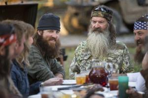 This undated image released by A&E shows Phil Robertson, flanked by his sons Jase Robertson, left, and Willie Robertson, from the series 'Duck Dynasty.'