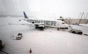 A Frontier airplane waits for passengers at O'Hare International Airport in Chicago Thursday.