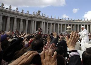Pope Francis waves to faithful as he is driven through the crowd in his popemobile in St. Peter's Square prior to the start of his weekly general audience at the Vatican, Wednesday, April 10, 2013.