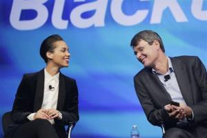 Thorsten Heins, right, CEO of Research in Motion, introduces singer Alicia Keys as the Global Creative director of Blackberry, Wednesday, Jan. 30, 2013 in New York.