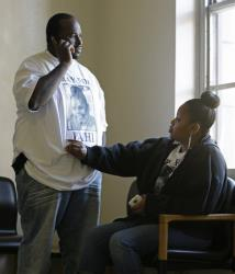 Nailah Winkfield, right, mother of 13-year-old Jahi McMath, touches her husband Martin Winkfield as they wait outside a courtroom in Oakland, Calif.