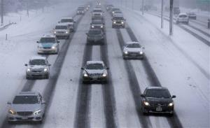 Motorists drive along a snow covered northbound Interstate-94 in Chicago yesterday.