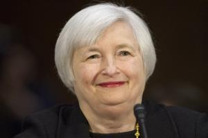 In this Nov. 14, 2013 file photo, Janet Yellen smiles as she is introduced as being the first female to be nominated as Federal Reserve Board chair, prior to testifying on Capitol Hill in Washington.
