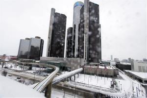 Snow falls on Detroit yesterday.