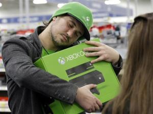 In this Nov. 22 photo, a Chicago man hugs his new Xbox One.
