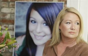 Sheila Pott poses with a portrait of her daughter Audrie in Los Altos, Calif., Thursday, May 23, 2013.