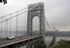 Traffic moves across the George Washington Bridge, in Fort Lee, NJ, where a top Christie aide apparently ordered lane closures to cause gridlock.