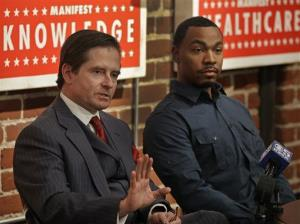 Attorney Christopher Dolan, left, representing the family of Jahi McMath, gestures beside Omari Sealey, Jahi's uncle, during a media conference in San Francisco.