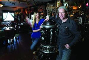 In this photo from Jan. 3, 2014, Brittany Mathis, left, and De Beyer pose for a portrait at Kaiserhof Restaurant in Montgomery, Texas.
