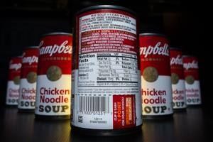 The nutrition information is shown on the back of a Campbell's Chicken Noodle soup can.