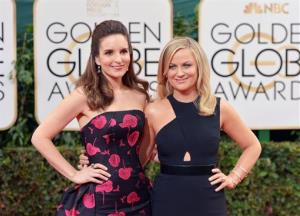 Tina Fey, left, and Amy Poehler arrive at the 71st annual Golden Globe Awards at the Beverly Hilton Hotel on Sunday, Jan. 12, 2014, in Beverly Hills, Calif.