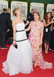 Jennifer Lawrence, left, and Drew Barrymore arrive at the 71st annual Golden Globe Awards at the Beverly Hilton Hotel on Sunday, Jan. 12, 2014, in Beverly Hills, Calif.