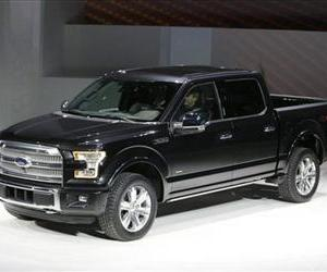 Ford unveils the new F-150 with a body built almost entirely out of aluminum at the North American International Auto Show in Detroit, Monday, Jan. 13, 2014.