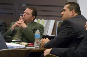 Former Fullerton police officers Jay Cicinelli, left, and Manuel Ramos listen during their trial over the death of Kelly Thomas, Jan. 8, 2014 in Santa Ana, Calif.