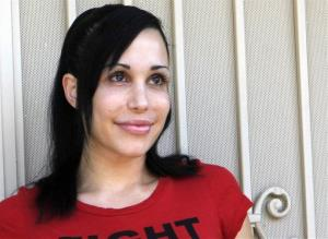 In this May 19, 2010 this file photo, Nadya Suleman stands  outside her home in La Habra, Calif.