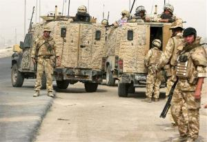 In this Oct 22, 2006 file photograph,  British troops man a checkpoint in Basra, Iraq.