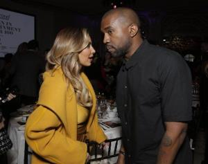 Kim Kardashian, left, and Kanye West attend THR's celebration of power 100 women in entertainment breakfast on Wednesday, Dec. 11, 2013 in Beverly Hills, Calif.