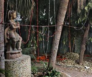 A statue stands at a spot which police say is where a Danish tourist was gang-raped in New Delhi, India, Jan. 15, 2014.