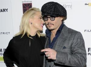 Actors Amber Heard and Johnny Depp attend the premiere of The Rum Diary at the Museum of Modern Art on Tuesday, Oct. 25, 2011 in New York.