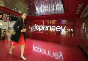 FILE - In this April 9, 2013 file photo, a customer leaves a J.C. Penney store in New York. J.C. Penney on Wednesday, Jan. 15, 2014 announced it will cut 2,000 jobs and close 33 stores as it tries to get back on the path to profitability....