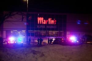 Police and emergency personnel respond to a shooting inside Martin's Supermarket in Elkhart, Ind., about 10:30 p.m. Wednesday, Jan. 15, 2014.