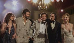 This film image released by Sony Pictures shows, from left, Amy Adams, as Sydney Prosser, Bradley Cooper, as Richie Dimaso , Jeremy Renner, as Mayor Carmine Polito, Christian Bale as Irving Rosenfeld, and Jennifer Lawrence as Rosalyn Rosenfeld, in a scene from American Hustle. The film was nominated for a Directors...