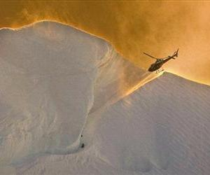 Japanese climber Hideaki Nara waits on the side of Mount Cook for rescue by helicopter in New Zealand's South Island, Friday, Dec. 5, 2008.