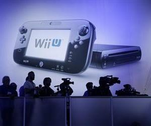 Members of the media watch a presentation at the Nintendo Wii U software showcase during the E3 game show in Los Angeles on June 11, 2013.