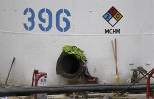 A storage tank with the chemical designation MCHM, the chemical that leaked into the Elk River, is shown at Freedom Industries storage facility in Charleston, W.Va.