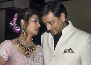This 2010 photo shows Sunanda Pushkar, left, and Shashi Tharoor at their wedding reception in New Delhi.